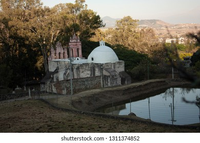 Chapel next to a waterhole in a magical town in a state of Mexico City