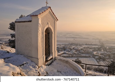 "chapel on the holy hill "" svaty kopecek "" covered in snow in the town mikulov south moravia czech republic , winter tourism, touristic destination, beautiful sky background"