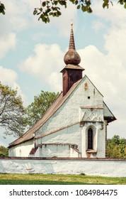 Chapel of Our Mother God near Veveri castle, Moravia, Czech republic. Travel destination. Religious architecture. Yellow photo filter.