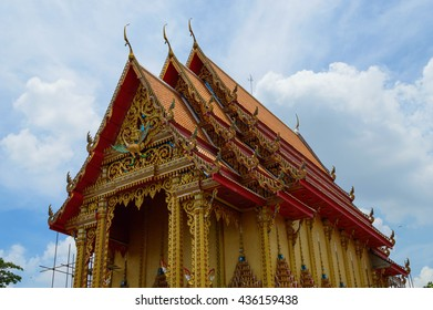 The Chapel of Phrachumrat Temple with Sky and cloud.  People in Thailand called Wat Phrachumrat. This temple is a temple of Thailand. Located in Pathum Thani province,  Lam Luk Ka district
