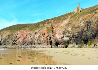 Chapel Porth beach and cliffs at low tide near St Agnes in Cornwall England