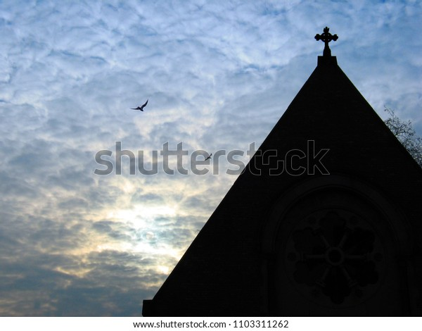 chapel silhouettes and clouds