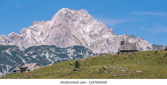 The chapel of Snow Mary on Velika planina (Big Pasture Plateau) in front of high mountain Ojstrica in Kamnik-Savinja Alps, Slovenia