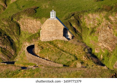 Chapel of St Nicholas, Lantern Hill, viewed from Capstone Point with Hillsborough behind, Ilfracombe, Devon, UK
