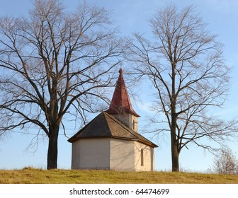 chapel and two trees