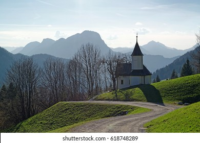 Chapel with the tyrolean mountains in the background, alps, Austria, Europe