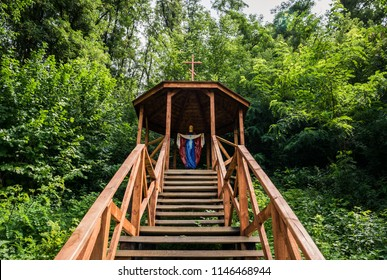 Chapel of the Virgin Mary on top of a hill in the forest. Religious traditions of Eastern Europe