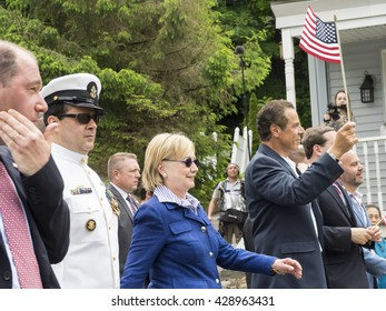 Chappaqua, NY, USA, May 30: President Bill Clinton, Presidential Candidate Hillary Clinton and NY Governor Andrew Cuomo march on Memorial Day May 30, 2016 in the Clinton's hometown Chappaqua NY.