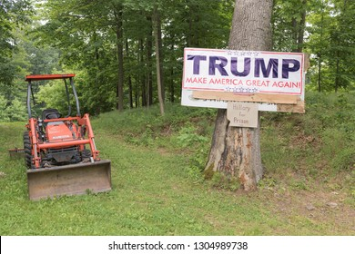 "Chappaqua, NY/USA- June 17, 2016:  Political Sign With Then -Presidential Candidate Donald Trump's Campaign Slogan ""Make America Great Again"" Nailed to a Tree With an Anti-HIllary Clinton Message"