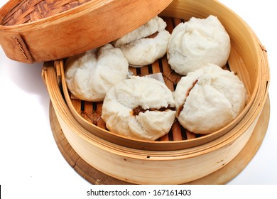 Char Siu Bao - Chinese steamed bun filled with bbq pork isolated on white