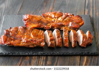 Char siu pork - Chinese bbq pork on the black stone board