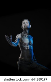 Character for computer game Bodyart cyborg, male with pattern on body on black background
