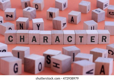 CHARACTER word on wooden cube isolated on orange background