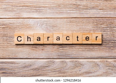 CHARACTER word written on wood block. CHARACTER text on wooden table for your desing, concept.