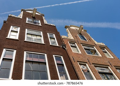 The characteristic facade of two historical Dutch houses in the center of Amsterdam in the Netherlands.