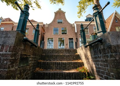 Characteristic houses with old architecture from the golden age in the Netherlands. Typical atmospheric houses in a Dutch town