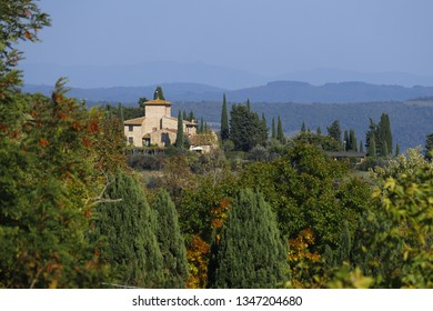 Characteristic landscape of Tuscany: hills, farmhouses, olive trees, cypresses, vineyards. The hills of Chianti south of Florence