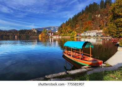 Characteristic wooden boat on Bled Lake, Slovenia, during a sunny autumn day.