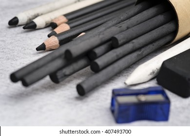 Charcoal artwork equipment on a white paper