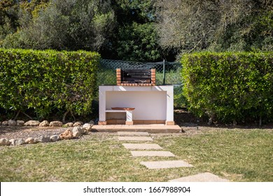 Charcoal barbecue in red brick in a garden in Portugal