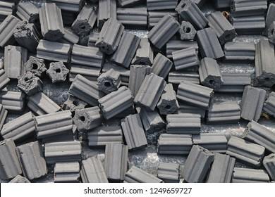 charcoal briquettes texture background.