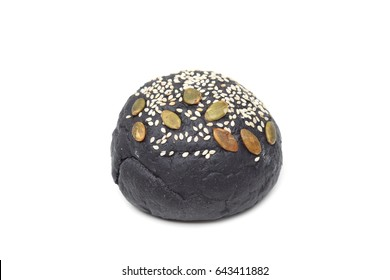 Charcoal bun with sesame and pumpkin seeds topping