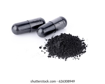 Charcoal capsules isolated on white