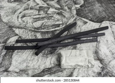 charcoal drawing and sticks