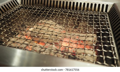charcoal grill close up with live flames