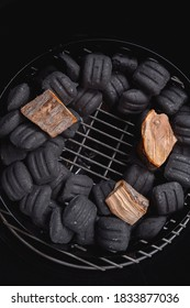 Charcoal grill filled with charcoal briquettes and wood for Smoking