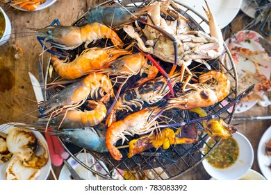 Charcoal grilled seafood at street food with spicy sauce enjoy to eat