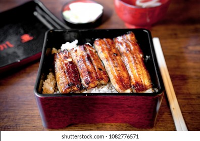 Charcoal grilled Unagi eel over rice or Japanese Unagi donburi (Unadon) rice recipe, famous street food of Narita, Chiba, Japan.