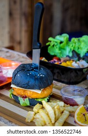 charcoal hamburger on wooden table in restaurant.