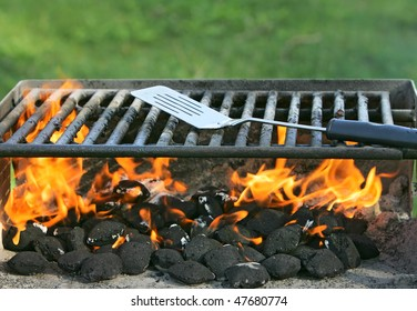 charcoal on fire heating up a barbecue pit before cooking