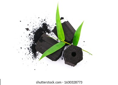 charcoal with powder and bamboo leaf top view isolated on white background.