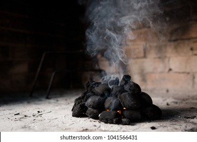 Charcoals getting heat for a braai