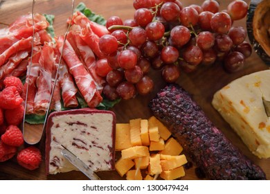 Charcuterie board of meats, cheeses and fruit