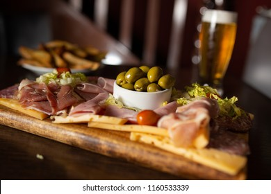 Charcuterie board with salami, pepperoni, ham, olives, cheese and vegetables
