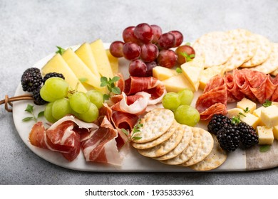 Charcuterie board for two with variety of cheese and meats