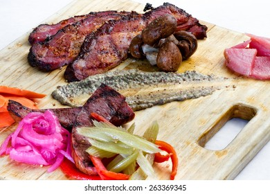 A charcuterie platter of smoked and cured meats