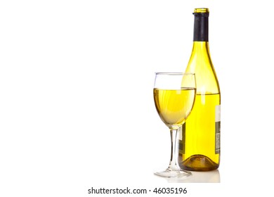 Chardonnay bottle next to a full glass of wine.