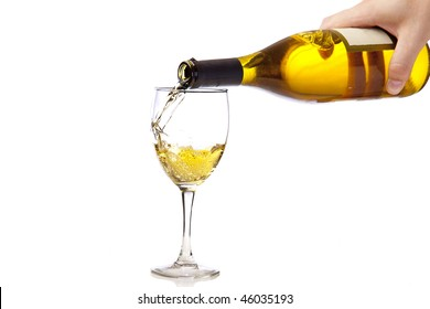 Chardonnay splashing into a wine glass.