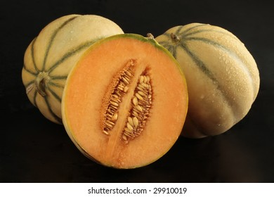 Charentais (melon) with half on black background