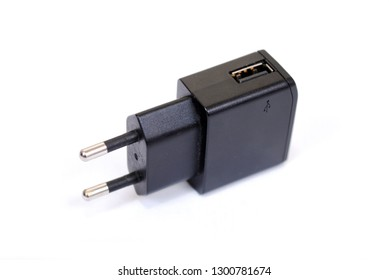 The charger adapter with USB an input in the socket of 220 Volts. It is isolated on a white background.