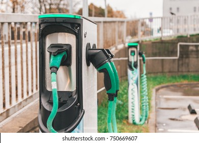 Charger for electric cars in a green color on the parking lot