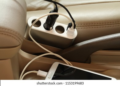 Charger plug charging smartphone in a car