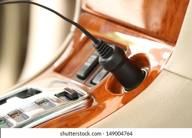 Charger plug on a luxury car