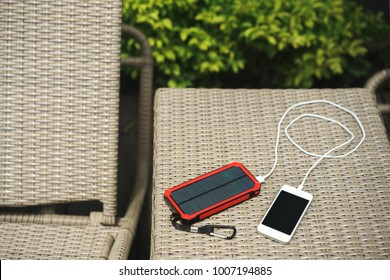 The charger is a verified bank on a solar panel. Charging smartphone phone from the solar battery.