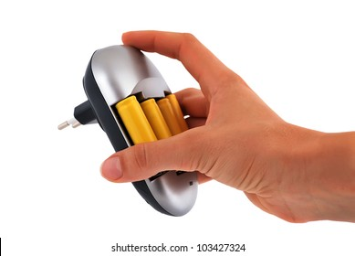 Charger with yellow batteries in hand on a white background