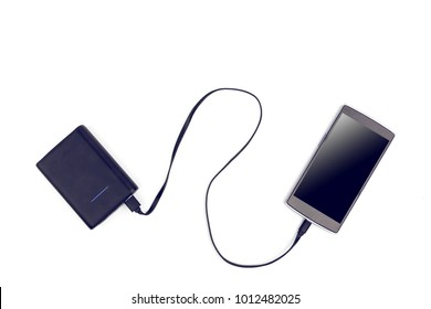 Chargering Smart Phone To Portable Battery Station On White Background